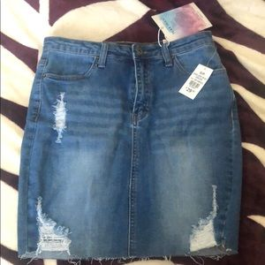 Medium wash distressed denim skirt